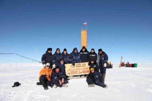 Russian researchers pose for a picture after reaching  the subglacial Lake Vostok in Antarctica on February 5, 2012
