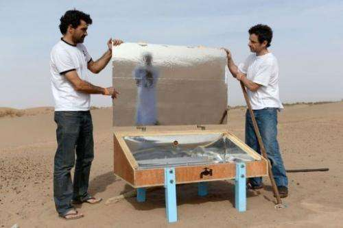 "Scientists show a nomad how to assemble a ""waterpod"" near the village of M'Hamid El Ghizlane in Zagora on March 16, 20"