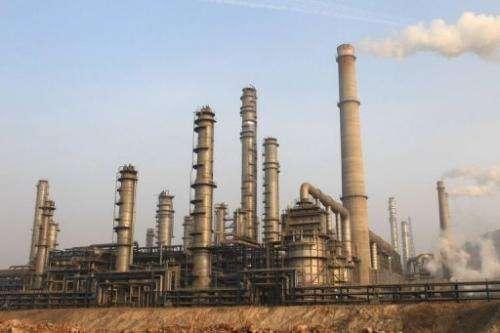 Smoke billows from chimneys at the Dalian Fujia Dahua Petrochemical factory in Dalian, China on January 18, 2013