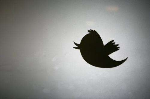 The Twitter logo is displayed at the entrance of Twitter headquarters in San Francisco on March 11, 2011 in California