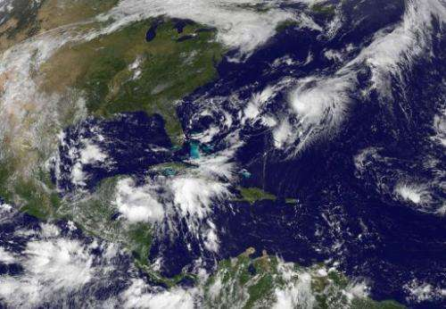 This NASA satellite image, released September 2013, shows Tropical Storm Gabrielle (Upper R) closing in on Bermuda