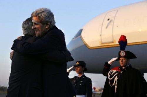 US Secretary of State John Kerry embraces US Ambassador to Italy David Thorne as he arrives in Rome, February 27, 2013