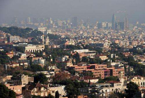 A general view shows the Catalan city of Barcelona shrouded by haze on December 9, 2013