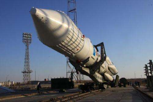 This file photo shows a Proton-M rocket, seen being rised to the launch pad at the Russian leased Baikonur cosmodrome in Kazakhs
