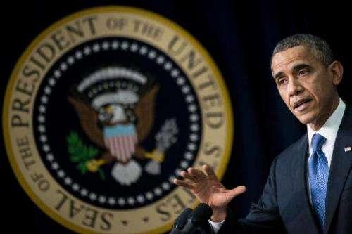 US President Barack Obama speaks at the White House on December 4, 2013 in Washington, DC