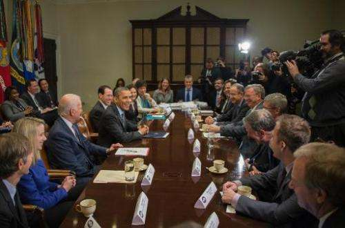 US President Barack Obama (4thL) and Vice President Joe Biden (3rd L) meet with executives from leading tech companies at the Wh