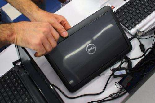 A customer looks at a Dell computer on February 5, 2013 in Miami, Florida