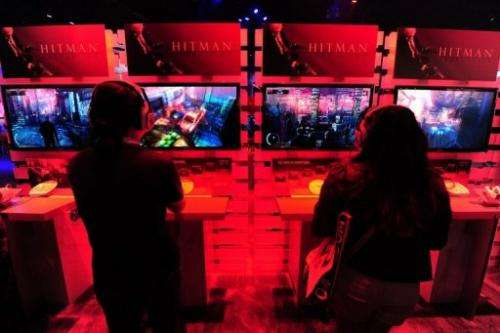 Gaming fans play Playstation 3's Hitman Absolution at the E3 videogame extravaganza in Los Angeles on June 7, 2012