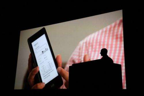 Jeff Bezos CEO of Amazon introduces the Kindle Paperwhite eReader during a press conference on September 6, 2012