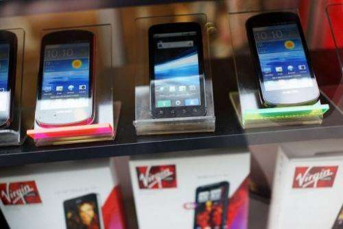Mobile phones sit on display in the window of a store on January 14, 2013 in New York City