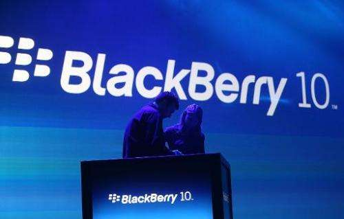 Workers prepare the podium before the start of the BlackBerry 10 launch event by Research in Motion at Pier 36 in Manhattan on J