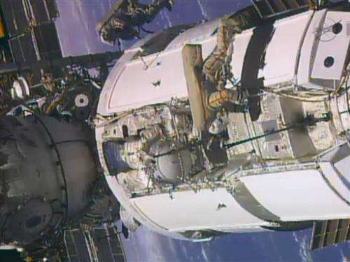 2 Russian astronauts tackle chores in spacewalk
