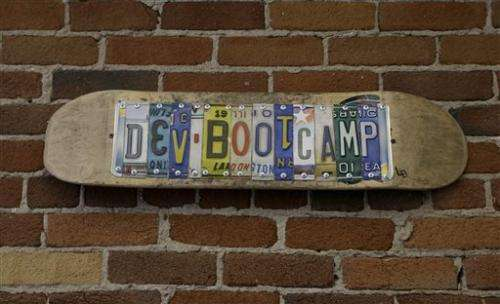 Coding boot camps promise to launch tech careers