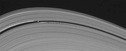 Saturn's little wavemaking moon