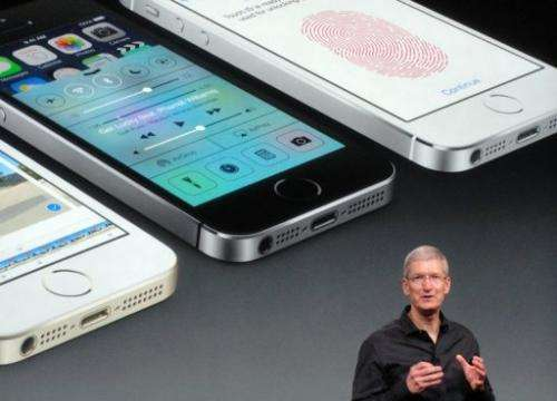 Apple chief executive Tim Cook introduces the new iPhone 5S on September 10, 2013 in Cupertino, California.