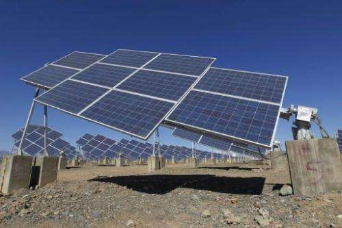 File picture shows a large solar panel in Hami, northwest China on May 8, 2013