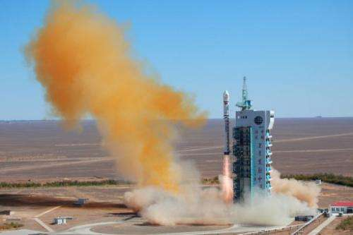 This file photo shows a rocket taking off with a satellite, in Jiuquan, China, on September 29, 2012