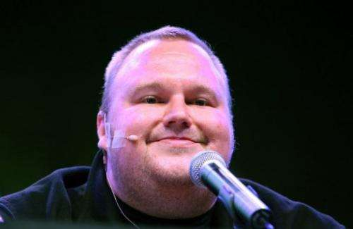 Megaupload founder Kim Dotcom smiles during at a press conference at his mansion in Auckland on January 20, 2013
