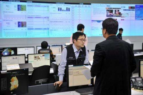 Members of the Korea Internet Security Agency are seen investigating cyber attacks, in Seoul, on March 20, 2013