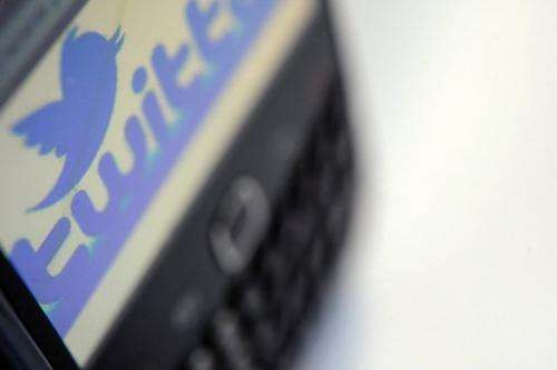 A picture taken on October 23, 2012 shows the screen of a blackberry phone on Twitter