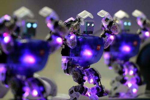"Humanoid robots dance at ""The Robot Museum"" in Madrid on November 28, 2013"
