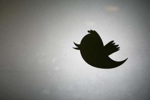 The Twitter logo displayed at the entrance of Twitter headquarters in San Francisco on March 11, 2011 in California
