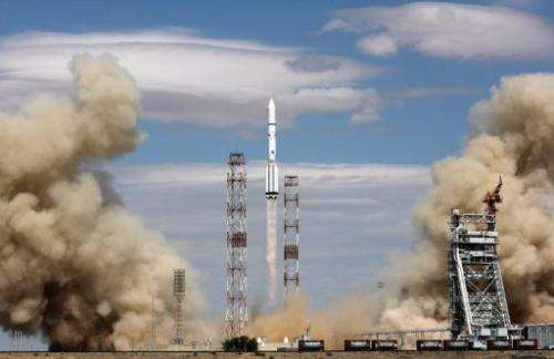 A picture taken on June 3, 2013 shows a Russian Proton-M carrier rocket blasting off from its launch pad in Kazakhstan