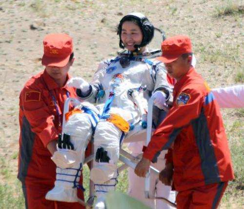 Image taken on June 29, 2012 shows China's first female astronaut Liu Yang being carried out of the Shenzhou-9 spacecraft in a r