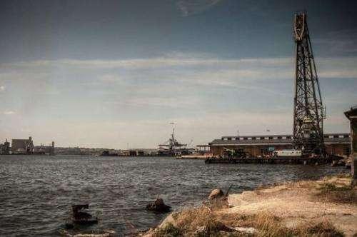 A crane works in clean tasks in Havana harbor, on April 18, 2013