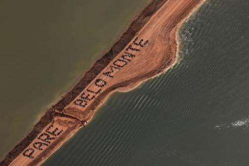 "Activists occupy an earthen dam and form the sentence ""Stop Belo Monte"", over the Xingu River in Para, northern Brazil"