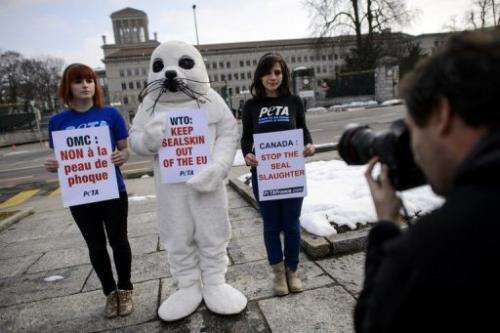 Activists stage a demonstration against seal hunting in front of WTO headquarters on February 18, 2013 in Geneva