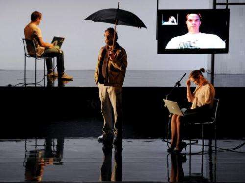 Actors rehearse a Skype chat scene from a theatre production, in Sydney, on September 12, 2012