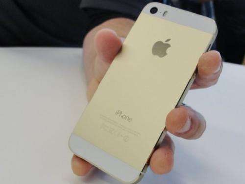 A gold iPhone 5S at Apple's headquarters in Cupertino, California on September 10, 2013