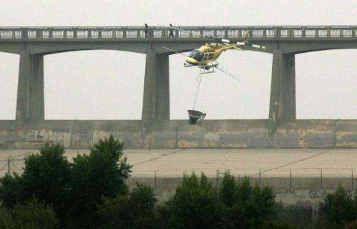 A helicopter spreads pesticide on August 15, 2005 in Los Angeles, California