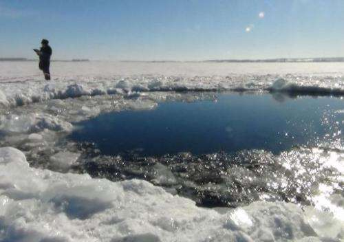 A hole in a frozen lake, at first thought to be where the meteor landed February 15, 2013, in Chebakul
