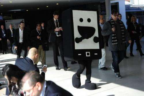 A hostess wearing a mobile phone costume walks at the 2013 Mobile World Congress in Barcelona on February 26, 2013