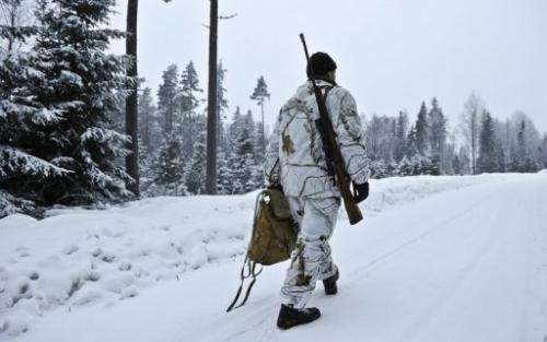A hunter is pictured as the wolf hunt season started in Hasselforsreviret, central Sweden, on January 15, 2011