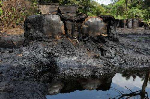 A locally built dump for crude oil waste from an illegal oil refinery in Bayelsa State, the Niger Delta, April 11, 2013