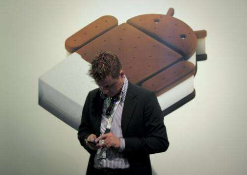 A man checks his mobile phone at the Mobile World Congress in Barcelona on February 29, 2012