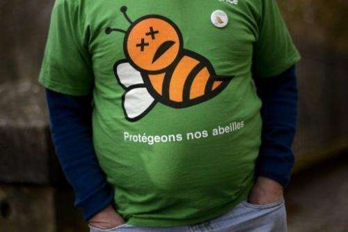 "A man in Berne on February 28, 2013 wears a T-shirt reading in French ""Protect our bees"""