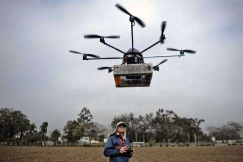 A man prepares to launch a drone in Lima, Peru on July 10, 2013