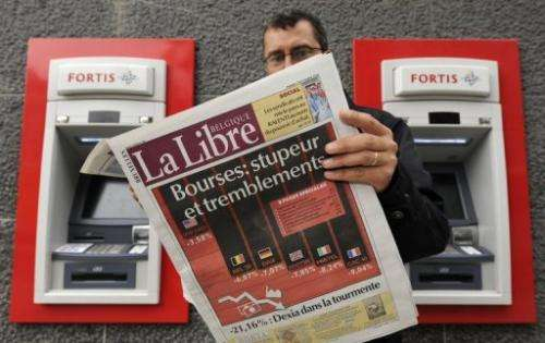A man reads La Libre Belgique newspaper in Brussels on October 7, 2008
