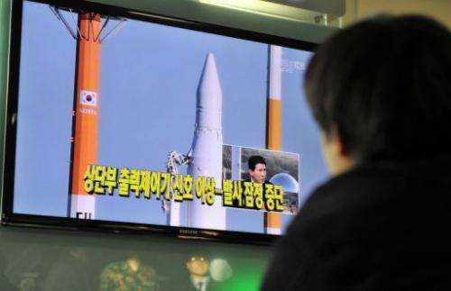 A man watches at a railway station in Seoul on November 29, 2012 live footage of an attempt to put a satellite in orbit