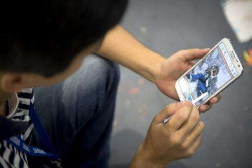 A man works on a Galaxy note II tablet during the 52nd edition of the IFA trade fair in Berlin on August 30, 2012