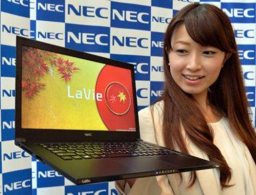 A model in Tokyo on October 15, 2013 displays the world's lightest 13.3-inch sized display notebook computer, NEC's Lavie Z LZ75