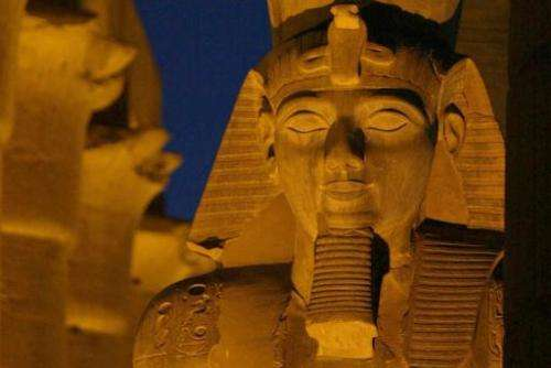 An ancient statue of the Egyptian Pharoah Ramses II adorns the pylon of the Luxor Temple in Luxor, Egypt 14 December 2002