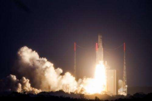 An Ariane 5 rocket carrying two satellites is pictured after blasting off on February 7, 2013, in Kourou, French Guiana