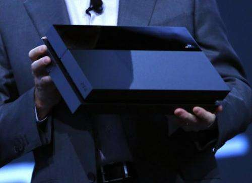 Andrew House, Sory President and CEO, holds up a Playstation 4 at the Sony Playstation E3 press conference June 10, 2013