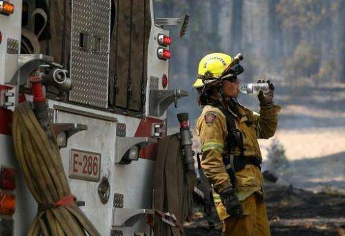 An El Dorado Hills firefighter takes a break from battling the Rim Fire on August 28, 2013 near Groveland, California