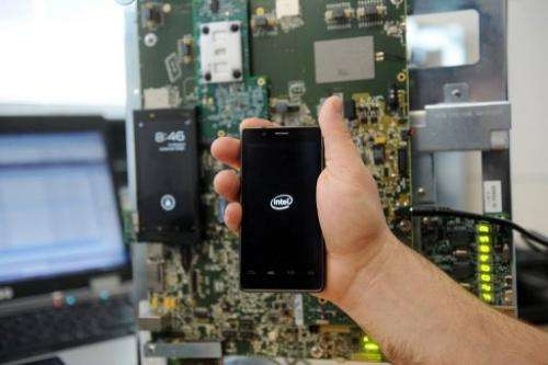 An emplyee holds a smatphone, at the Intel smartphones' research center in Toulouse, on March 2, 2012